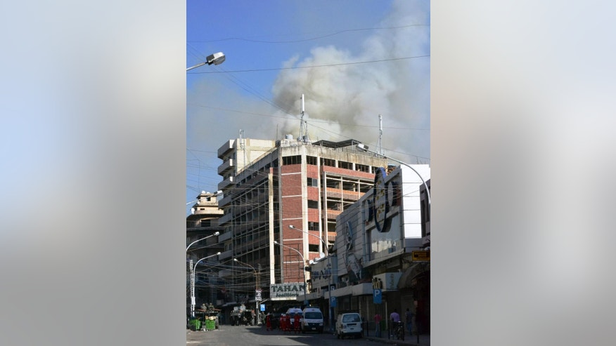 Smoke rise from buildings that were attacked during clashes between the Lebanese army and Islamic militants in the northern port city of Tripoli, Lebanon, Saturday, Oct. 25, 2014. Lebanese troops battled Islamic militants in Tripoli for a second day Saturday, with at least one person killed and a dozen people wounded in the clashes, the Lebanese army and state media said. (AP Photo)