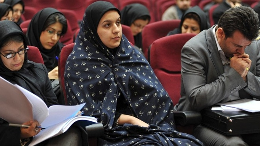 In this picture taken on Dec. 15, 2008, Iranian Reyhaneh Jabbari, center, sits while attending her trial in a court in Tehran, Iran. Jabbari was hanged on Saturday, Oct. 25, 2014, who was convicted of murdering a man she said was trying to rape her, the official IRNA news agency reported.