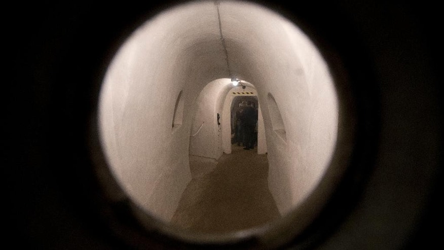 Benito Mussolini's first air raid shelter, created in old wine cellars, is seen through the peephole in a steel door, in Villa Torlonia in Rome, Saturday, Oct. 25, 2014. After the outbreak of World War II, the shelter was quickly constructed in 1940 in what had been the wine cellar of Torlonia noble family, who lived there before Mussolini took up residence during his Fascist rule. The city of Rome now owns the villa and opened the shelter to tourists with reservations starting from Oct. 31. (AP Photo/Andrew Medichini)