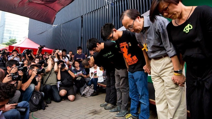 Oct. 26, 2014: Pro-democracy leaders, standing from left, founder of the Occupy Central civil disobedience movement Benny Tai, students leaders Alex Chow, Joshua Wong, pro-democracy legislator Alan Leong and a representative from a students supporting union Wu Mei Lin bow for an apology as they scrapped the vote on their next step, in Hong Kong. (AP)