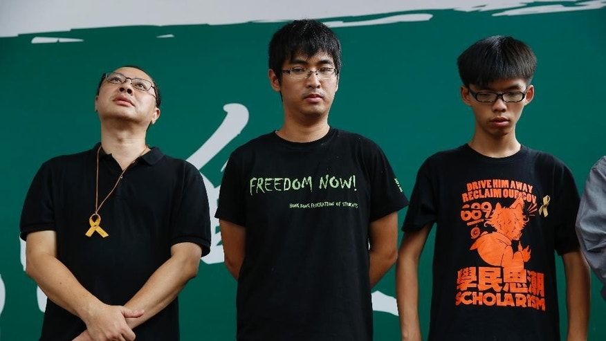 Oct. 26, 2014: Pro-democracy leaders from left, founder of the Occupy Central civil disobedience movement Benny Tai, students leaders Alex Chow and Joshua Wong attend a news conference in Hong Kong as they made apology for the cancellation of the scheduled referendum. (AP)