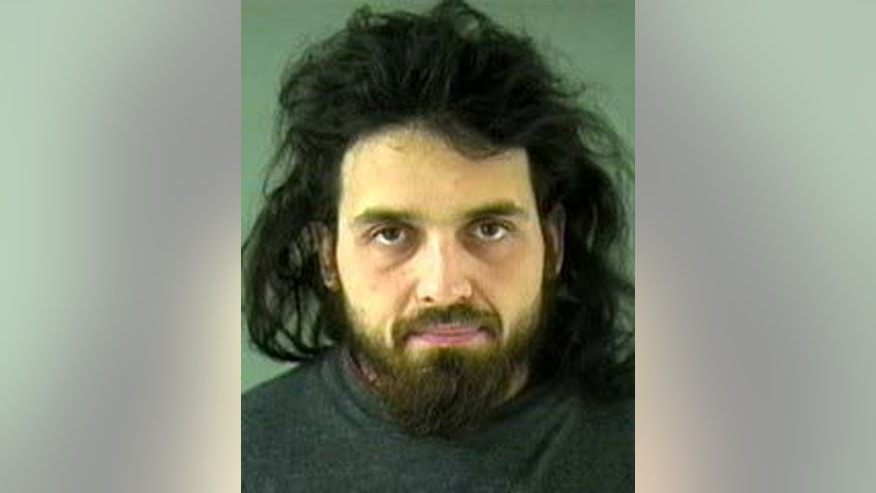 This image provided by the Royal Canadian Mounted Police shows and undated image of Michael Zehaf-Bibeau, 32, who shot a soldier to death at Canada's national war memorial Wednesday, Oct. 22, 2014 and was eventually gunned down inside Parliament by the sergeant-at-arms. (AP Photo/Vancouver Police via The Royal Canadian Mounted Police)
