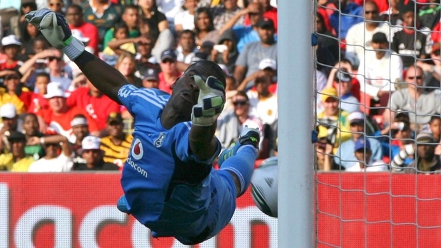 July 23, 2011: In this file photo, Orlando Pirates goalkeeper Senzo Meyiwa dives but fails to stop the ball going below his hand, from a free kick by Tottenham Hotspur Rafael Van der Vaart, during the 2011 Vodacom Challenge at Ellis Park stadium in Johannesburg, South Africa.