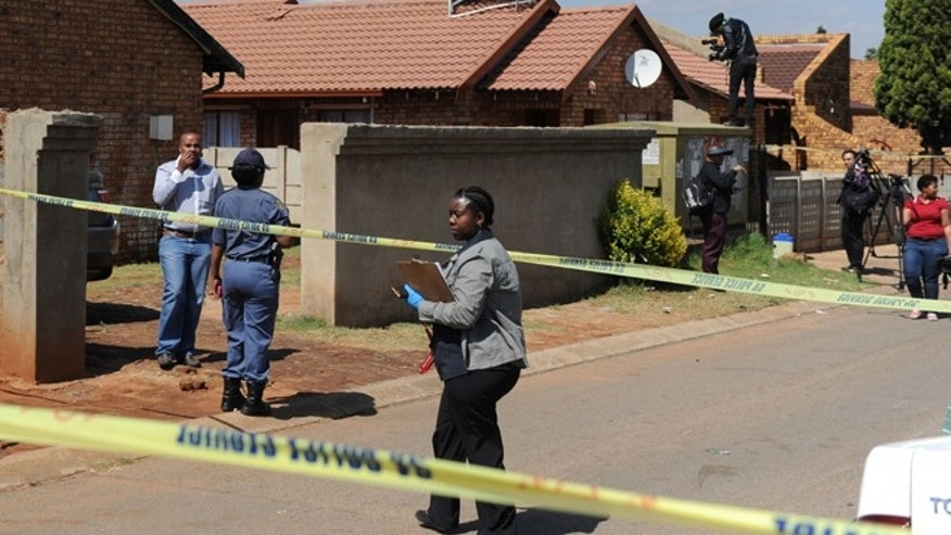 Oct. 27, 2014: Police, forensic investigators and press work outside the home of actress and singer, Kelly Khumalo, in Vosloorus, east of Johannesburg.