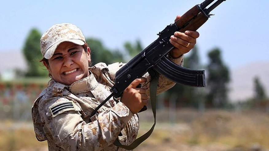 July 3, 2014: In this photo, a member of an elite unit of women Kurdish Peshmerga fighters trains in Sulaimaniyah, 160 miles northeast of Baghdad, Iraq. (AP)