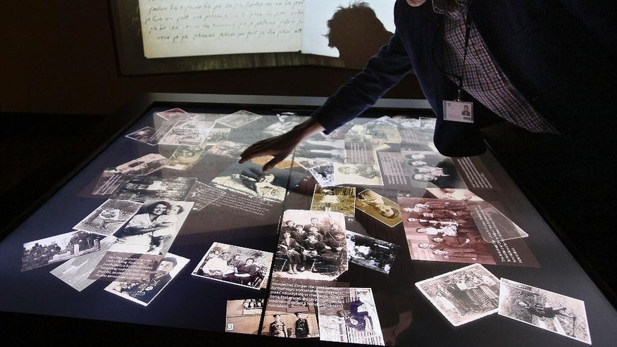 In this photo taken Friday, Oct. 10, 2014, shows a display photographs and texts from the years 1919 to 1939 at the POLIN Museum of the History of Polish Jews  in Warsaw, Poland. The museum, which unveils its core exhibition to the public Tuesday, Oct. 28, 2014, narrates 1,000 years of Jewish life in Poland. (AP Photo/Czarek Sokolowski)