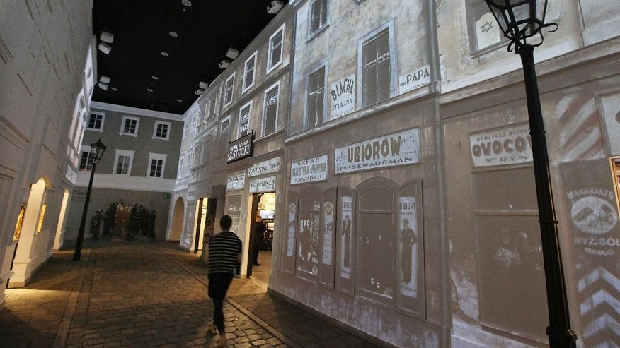 In this photo taken Friday, Oct. 10, 2014, a gallery depicting a street scene typical of those found between 1919 and 1939 at the POLIN Museum of the History of Polish Jews in Warsaw, Poland. The museum, which unveils its core exhibition to the public Tuesday, Oct. 28, 2014, narrates 1,000 years of Jewish life in Poland. (AP Photo/Czarek Sokolowski)