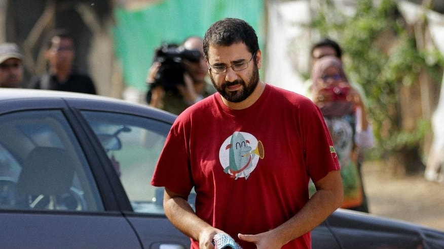Egypt's most prominent activist Alaa Abdel-Fattah arrives outside a court that convicted 23 activists of staging an illegal demonstration and sentenced them each to three years in jail, in Cairo, Egypt, Sunday, Oct. 26, 2014. Among the 23 is Sanaa Seif, who hails from a family of longtime rights campaigners, including her late father Ahmed Seif al-Dawla and brother Alaa Abdel-Fattah. Another defendant is Yara Sallam, a prominent rights lawyer. Sunday's verdicts, which can be appealed, comes at a time when Egypt is swept by nationalist sentiments following a dramatic surge in attacks blamed on Islamic militants on troops and security forces in the Sinai Peninsula while witnessing a smear campaign targeting many of the secular pro-democracy campaigners behind the 2011 uprising. (AP Photo/Hussein Tallal)