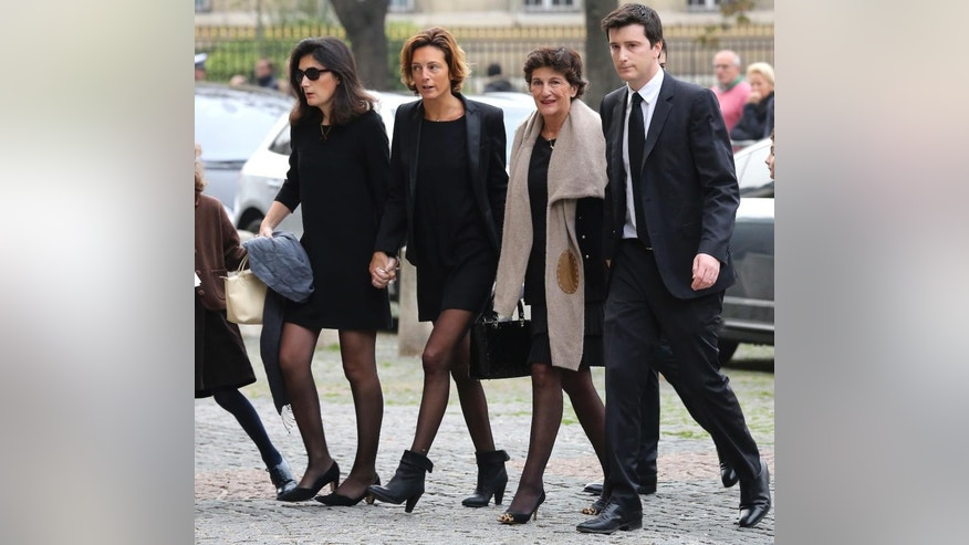 Bernadette de Margerie, second right, widow of former Total SA Chief Executive Christophe de Margerie, and relatives arrive at a funeral service for her husband at Saint Sulpice church in Paris, France, Monday, Oct. 27, 2014. Margerie and three French crew members were killed Oct. 20, when the business jet they were in clipped an airport snowplow on takeoff at Moscow's Vnukovo airport, crashed and burst into flames. (AP Photo/Remy de la Mauviniere)