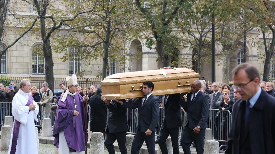 Pallbearers carry the coffin of former Total SA Chief Executive Christophe de Margerie before a funeral service at Saint Sulpice church in Paris, France, Monday, Oct. 27, 2014. Margerie and three French crew members were killed Oct. 20, when the business jet they were in clipped an airport snowplow on takeoff at Moscow's Vnukovo airport, crashed and burst into flames. (AP Photo/Remy de la Mauviniere)