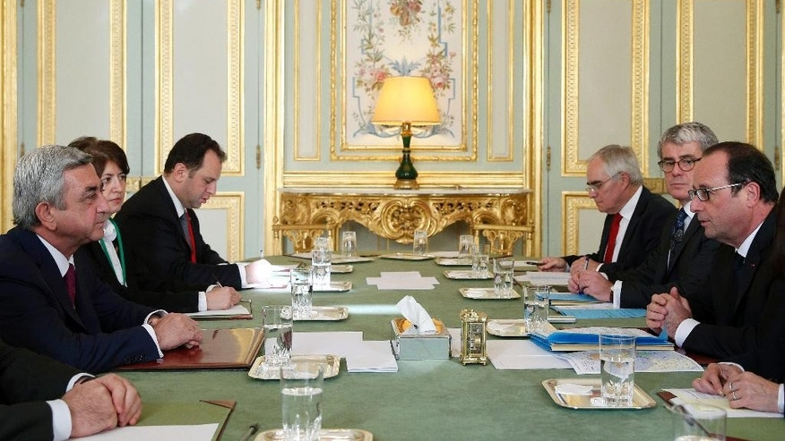 French President Francois Hollande, right, talks with his Armenian counterpart Serge Sarkisian at the Elysee Palace in Paris, Monday, Oc. 27, 2014.  Sarkisian and  Azerbaijan's President Ilham Aliyev are expected to meet in Paris to discuss the situation over the South Caucasus region Nagorno-Karabakh. (AP Photo/Yoan Valat, Pool)