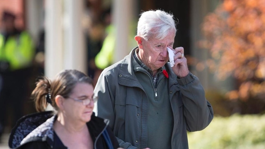 Jack Terpstra, from Mount Hope, Ont., wipes tears from his eyes after paying his respects at the public visitation for Cpl Nathan Cirillo at the Markey-Dermody Funeral Home in Hamilton, Ontario on Monday, Oct. 27, 2014. Cirillo, the 24-year-old reservist with the Argyll and Sutherland Highlanders of Canada, was gunned down Oct. 22 as he stood ceremonial guard at the National War Memorial in Ottawa. (AP Photo/The Canadian Press, Peter Power)