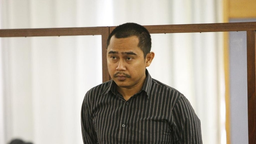 Malaysian military officer Muhammad Rizalman Ismail stands in the dock at a court hearing on Tuesday, Oct. 28, 2014, in Wellington, New Zealand. Rizalman was extradited to New Zealand last week after earlier leaving the country under the protection of diplomatic immunity. Rizalman has been charged with burglary and assault with the intent to rape in a case that has proved to be diplomatically embarrassing for both Malaysia and New Zealand. (AP Photo/Nick Perry)
