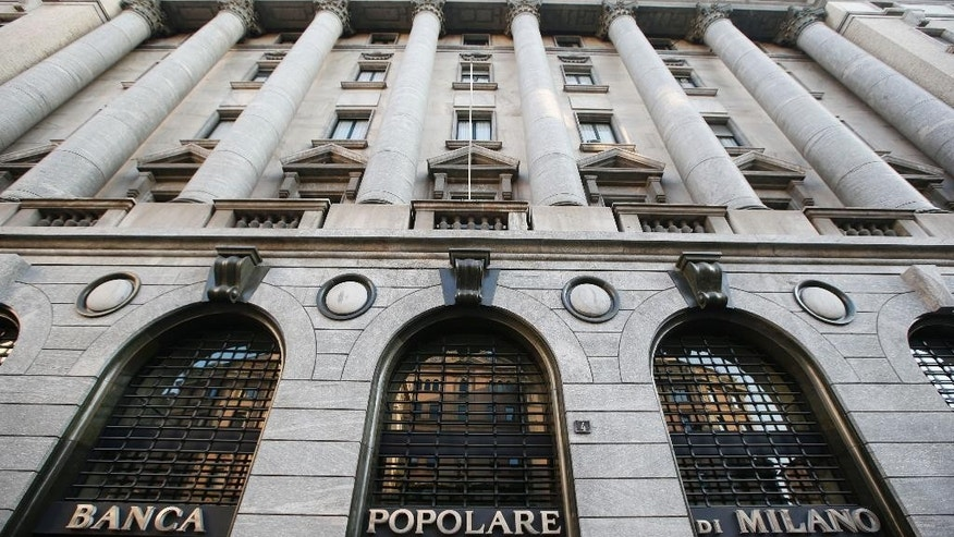"A view of a ""Banca Popolare di Milano"" bank branch in Milan, Italy, Sunday, Oct.26, 2014. The European Central Bank says 13 of Europe's 130 biggest banks have flunked an in-depth review of their finances and need an extra 10 billion euros ($12.5 billion) to cushion themselves against any future crises. ECB officials said Sunday the test had been tougher than similar reviews in 2011 and 2010, which gave a pass to banks that later needed bailouts. (AP Photo/Luca Bruno)"