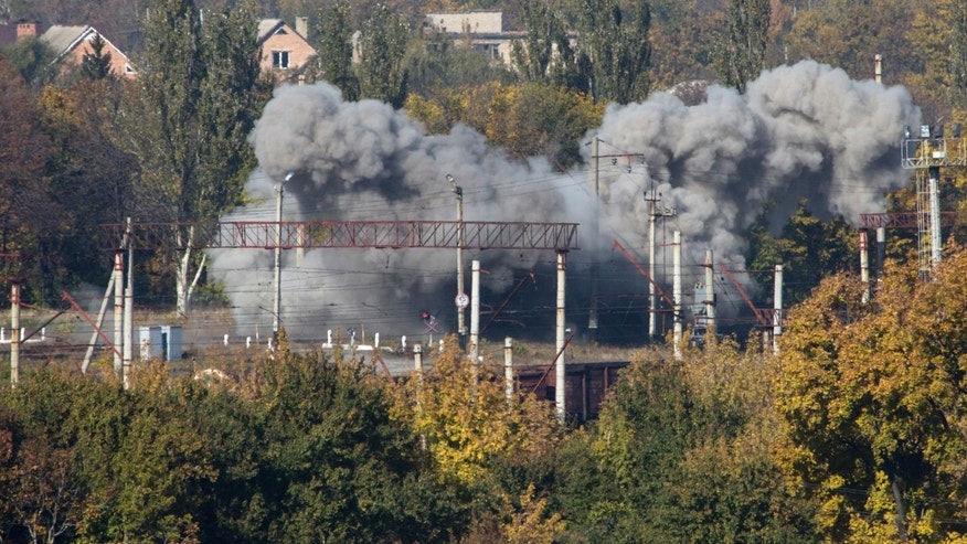 Oct. 12, 2014 - FILE photo of a shell exploding at a rail road near the Donetsk airport, during an artillery battle between pro-Russian rebels and Ukrainian government forces in eastern Ukraine. Poland's defense minister tells the AP the country will move thousands of troops toward its eastern borders in a historic realignment of a military structure. The troops are needed east because of the conflict in neighboring Ukraine.