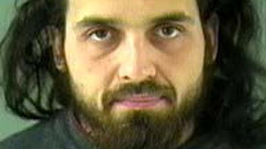 This image provided by the Royal Canadian Mounted Police shows an undated image of Michael Zehaf-Bibeau, 32, who shot a soldier to death at Canada's national war memorial Wednesday and was eventually gunned down inside Parliament by the sergeant-at-arms. (AP Photo/Vancouver Police via The Royal Canadian Mounted Police)