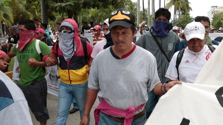 In this Oct. 17, 2014 photo, Clemente Rodriguez Moreno, a father of a missing rural teachers college student, participates in a protest march demanding the safe return of 43 missing students, in Acapulco, Mexico. Sleep has eluded the 46-year-old father, since his 19-year-old son Christian disappeared with his college classmates on Sept. 26. When the day's distractions of meals, meetings, marches end, parents of the missing are left with their thoughts, questions and a simmering rage. (AP Photo/Eduardo Verdugo)