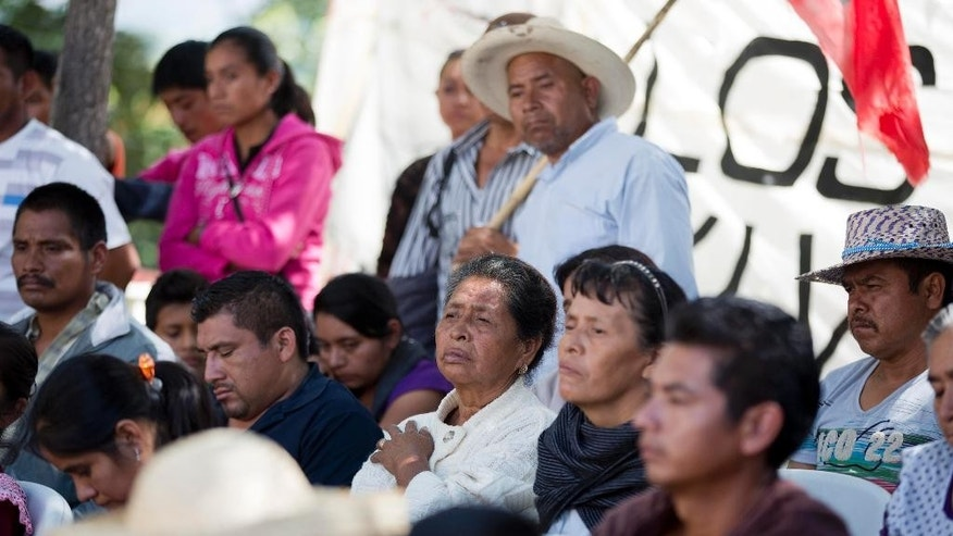 In this Oct. 6, 2014 file photo, relatives of missing students attend a press conference as they wait for news the Raul Isidro Burgos school in Tixtla's Ayotzinapa neighborhood, in southern Mexico. Night is the most difficult time at the rural teachers college, where families have stayed on thin, bare mattresses in classrooms since 43 students went missing a month ago. When the day's distractions of meals, meetings, marches end, the parents are left with their thoughts, questions and a simmering rage. (AP Photo/Eduardo Verdugo, file)