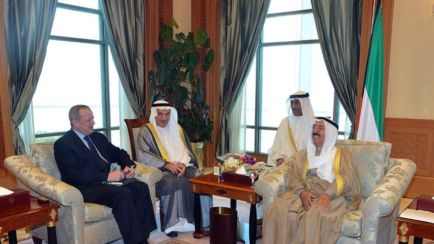 Kuwait's ruling emir, Sheik Sabah Al Ahmad Al Sabah, right, meets Gen. John Allen, left, a retired U.S. general in charge of coordinating the U.S.-led coalition's fight against Islamic State militants, in Kuwait city, Kuwait, Monday, Oct. 27, 2014. Allen appealed for Western and Arab partners to do more to combat the group's extremist ideology during a meeting in Kuwait on Monday. He urged coalition members to lay out concrete plans to counter the militants' message online and in the press. (AP Photo/KUNA)