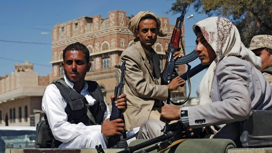 Houthi Shiite rebels ride in a military truck while patrolling a street in Sanaa, Yemen, Monday, Oct. 27, 2014. Fighting in Yemen's central Bayda province between Shiite Houthi rebels and the influential Qifa tribe in the town of  Radda, some 200 kilometers (125 miles) south of the capital, Sanaa, killed at least 250 people over three days of clashes, security officials said Monday. Fighters from the Qifa tribe forced the Houthis out of the Manasih area in Radda, said the officials. A peace agreement signed between the Houthis and the government so far has failed to end the fighting. (AP Photo/Hani Mohammed)