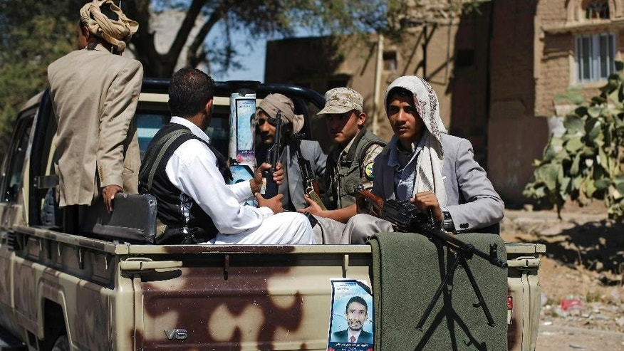 Houthi Shiite rebels ride on a military truck while patrolling a street in Sanaa, Yemen, Monday, Oct. 27, 2014.  Fighting in Yemen's central Bayda province between Shiite Houthi rebels and the influential Qifa tribe in the town of  Radda, some 200 kilometers (125 miles) south of the capital, Sanaa, killed at least 250 people over three days of clashes, security officials said Monday. Fighters from the Qifa tribe forced the Houthis out of the Manasih area in Radda, said the officials. A peace agreement signed between the Houthis and the government so far has failed to end the fighting. (AP Photo/Hani Mohammed)