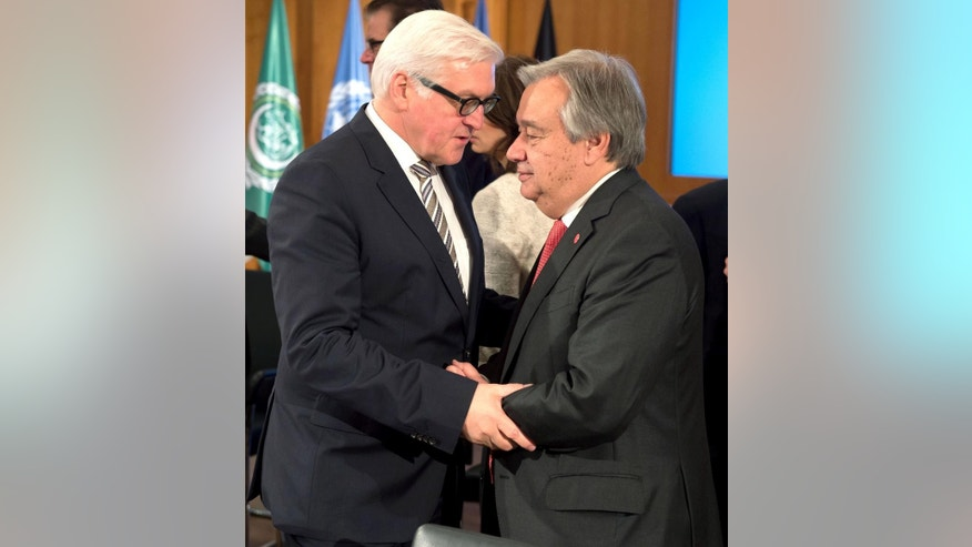 Oct. 28, 2014: German Foreign Minister  Frank-Walter Steinmeier , left, welcomes the head of the United Nations refugee agency, Antonio Guterres, at a conference in Berlin. (AP/dpa,Tim Brakemeier)