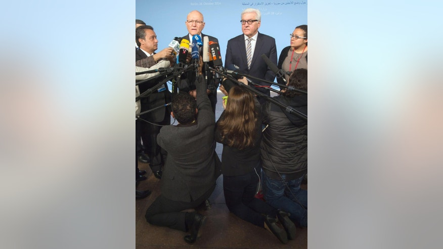 Oct. 28, 2014: German Foreign Minister Frank-Walter Steinmeier, right, and the Prime Minister of Lebanon, Tammam Salam give a statement prior to a conference in Berlin.  (AP/dpa,Tim Brakemeier)
