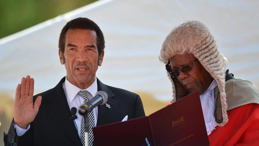 President Lt Gen. Seretse Khama Ian Khama, left, is sworn in for a second and final term as Botswana president by the Chief Justice Maruping Dibotelo, right, at the National Assembly buildings in Gaborone, Botswana, Tuesday, Oct. 28 2014. The ruling party won the country's elections that were held Oct. 24. (AP Photo)