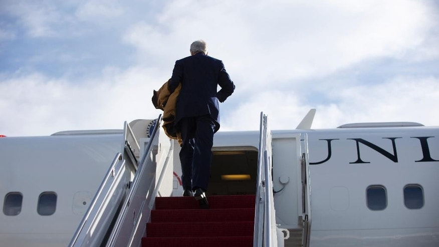 Secretary of State John Kerry boards his plane at Andrews Air Force Base, Md., Tuesday, Oct. 28, 2014, en route to Ottawa, Canada. Kerry is traveling to Ottawa to offer condolences to Canada and express U.S. solidarity in the fight against extremist violence. (AP Photo/Carolyn Kaster, Pool)