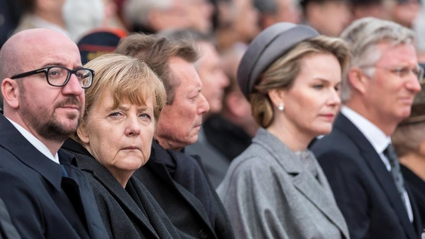 Germany's Chancellor Angela Merkel, second from left, Belgium's Prime Minister Charles Michel, left, Belgium's King Philippe, right, Queen Mathilde, second from right, and Luxembourg's Grand Duke Henri attend a ceremony at the King Albert I Monument at the Northsea town of Nieuwpoort, Belgium on Tuesday, Oct. 28, 2014. The ceremony commemorates the WWI 100th anniversary of the First Battle of Ypres, focusing on the themes of the refusal to surrender and the flooding of the Yser plain. (AP Photo/Geert Vanden Wijngaert)