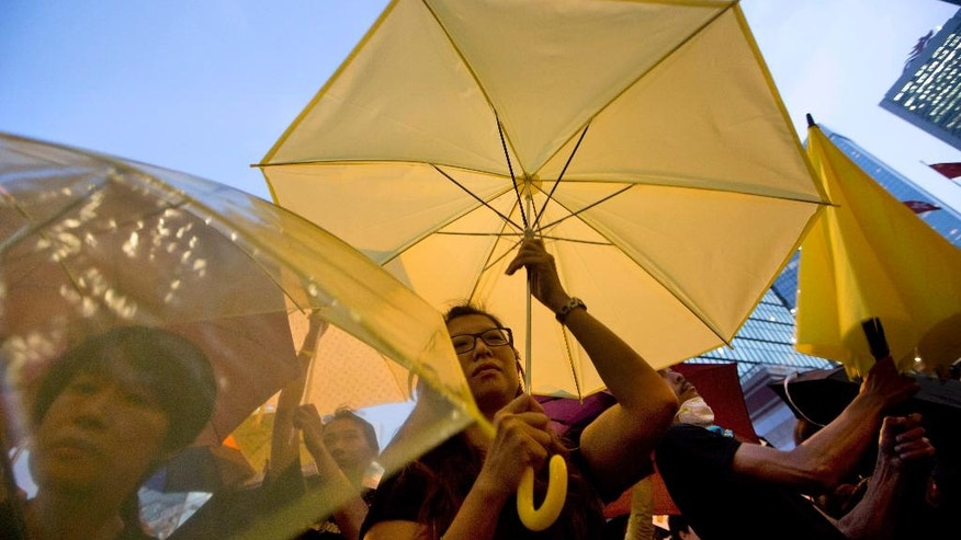 Oct. 28, 2014: Pro-democracy protesters hold umbrellas at a rally in the occupied areas outside government headquarters in Hong Kong's Admiralty. (AP)