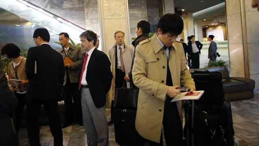 October 27, 2014: Junichi Ihara, director general of the Asia and Oceania affairs bureau of Japanese Foreign Ministry, center, waits in the lobby of the Koryo Hotel with the rest of the Japanese delegation in Pyongyang, North Korea. (AP Photo/Wong Maye-E)
