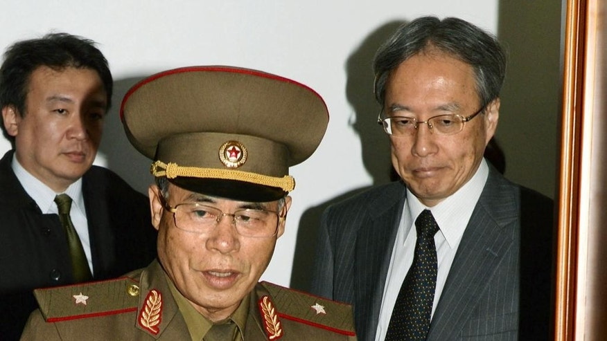 So Tae Ha, center, chairman of North Korea's Investigation Committee, center, and Junichi Ihara, right, Japan's director-general of the Asia and Oceania Affairs Bureau enter a meeting room in Pyongyang, North Korea, Tuesday, Oct. 28, 2014. Japanese and North Korean officials held talks in Pyongyang for the first time in 10 years Tuesday, meeting to assess progress into North Korea's investigation into the fates of Japanese citizens who were abducted in the 1970s and '80s. (AP Photo/Kyodo News) JAPAN OUT, CREDIT MANDATORY