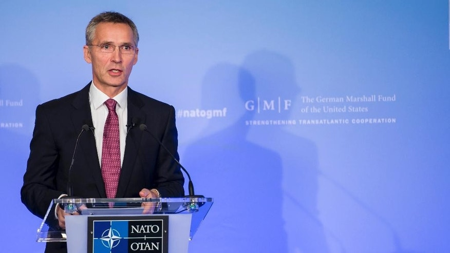 "NATO Secretary General Jens Stoltenberg gives a policy speech entitled ""A unique Alliance with a clear course"" at an event hosted by the German Marshall Fund of the United States, in Brussels on Tuesday, Oct. 28, 2014. (AP Photo/Geert Vanden Wijngaert)"