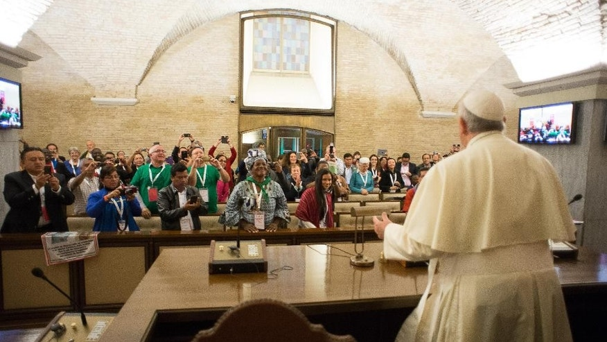 In this photo provided by the Vatican newspaper L'Osservatore Romano, Pope Francis meets with participants of the Global Meeting of Popular Movements, at the Vatican, Tuesday, Oct. 28, 2014. (AP Photo/L'Osservatore Romano)