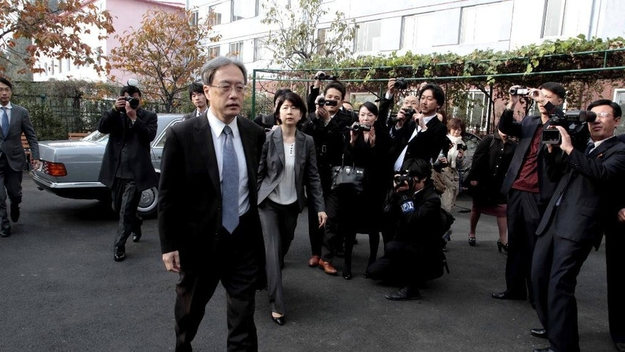 Junichi Ihara, director general of the Asia and Oceania Affairs Bureau of Japan's Foreign Ministry, arrives at the Special Investigation Committee office to hold a meeting on abduction probe with North Korean officials in Pyongyang, North Korea, Wednesday, Oct. 29,  2014. The second and final day of talks was underway Wednesday between North Korean and Japanese officials assessing progress into an investigation of the fates of Japanese citizens abducted by North Korea in the 1970s and '80s. The abduction issue has long been a major obstacle in the frosty ties between the two nations, which have no formal diplomatic relations. (AP Photo/Kim Kwang Hyon)
