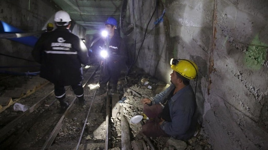 Rescue workers use pipes to pump water out of the mine after underground waters flooded a section of the Has Sekerler mine in the town of Ermenek, some 500 kilometers (300 miles) south of Ankara, close to Turkey's Mediterranean coast, early Wednesday, Oct. 29, 2014. Surging water trapped at least 18 workers Tuesday in the coal mine, officials and reports said - an event likely to raise even more concerns about the nation's poor workplace safety standards. Initial reports said flooding inside the coal mine near caused a cave-in, but subsequent reports workers were trapped by the water. (AP Photo/Depo Photos)