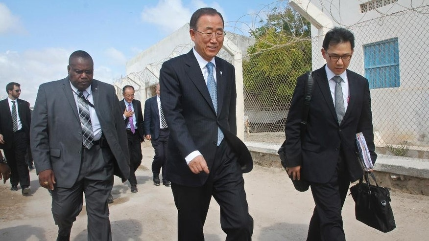 U.N. Secretary-General Ban Ki-moon, center, walks inside the heavily-protected airport complex during a visit to Mogadishu, Somalia Wednesday, Oct. 29, 2014. Ban's fashion choices are not typically newsworthy but are significant in Mogadishu. On his trip in 2011, he wore a U.N.-branded bullet-proof vest, and the fact that his security advisers did not insist on war-time protection on this trip, at least inside the well-protected airport complex, is seen as another indication of Mogadishu's improving security. (AP Photo/Farah Abdi Warsameh)