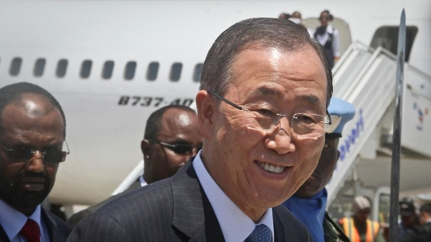 U.N. Secretary-General Ban Ki-moon turns as he receives a salute from an honor guard inside the heavily-protected airport complex during a visit to Mogadishu, Somalia Wednesday, Oct. 29, 2014.  Ban's fashion choices are not typically newsworthy but are significant in Mogadishu. On his trip in 2011, he wore a U.N.-branded bullet-proof vest, and the fact that his security advisers did not insist on war-time protection on this trip, at least inside the well-protected airport complex, is seen as another indication of Mogadishu's improving security. (AP Photo/Farah Abdi Warsameh)