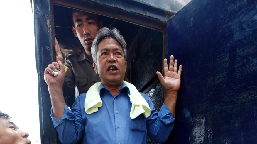 In this May 6, 2014 photo, activist Win Cho gets off a police truck upon arrival for his trial at a township court in Yangon, Myanmar. Win Cho, who comes from a well-educated upper-class family, has been in and out of prison in the last two years for engaging in peaceful protests. He is now serving three months for a January rally calling for the release of all remaining political prisoners, constitutional change and the establishment of a farmers' union in the country. He is among one of more than 200 people who have been detained in the last year including peaceful protesters, journalists and activists. Critics say as long as restrictive laws remain on the books, those numbers will continue to climb. (AP Photo/Khin Maung Win)