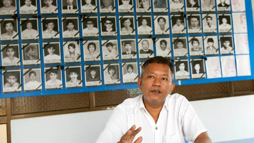 In this Oct. 20, 2014 photo, Bo Kyi, a Myanmar former political prisoner, speaks during an interview in Yangon, Myanmar. As a college student Bo Kyi joined the 1988 peaceful uprising against Myanmar's then-ruling military regime. His activism led to his arrest and seven years behind bars, where he was often denied food and water, deprived or sleep, beaten and placed in solitary confinement. He says at least 28 junta-era political prisoners remain behind bars, and that hundred of protesters, writers and land grab victims have been detained under the nominally civilian government of President Thein Sein. (AP Photo/Khin Maung Win)