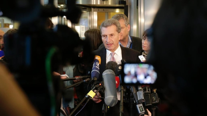 EU Commissioner for Energy Guenther Oettinger addresses the media at the European Commission headquarters in Brussels, Wednesday, Oct. 29, 2014. Trilateral gas talks between the European Union, Russia and Ukraine about gas supply from Russia for Europe during the upcoming winter take place in Brussels. (AP Photo/Yves Logghe)