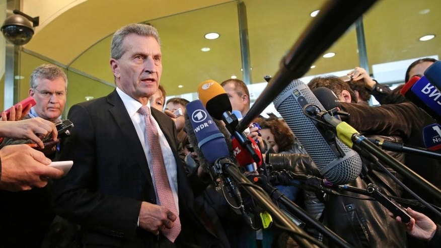 EU Commissioner for Energy Guenther Oettinger addresses the media at the European Commission headquarters in Brussels, Wednesday, Oct. 29, 2014. The European Union's energy chief is hoping Wednesday's negotiations between Ukraine and Russia will assure the breakthrough needed to guarantee that Russian gas will continue to flow to Ukraine and, by extension, parts of the EU this winter. (AP Photo/Yves Logghe)