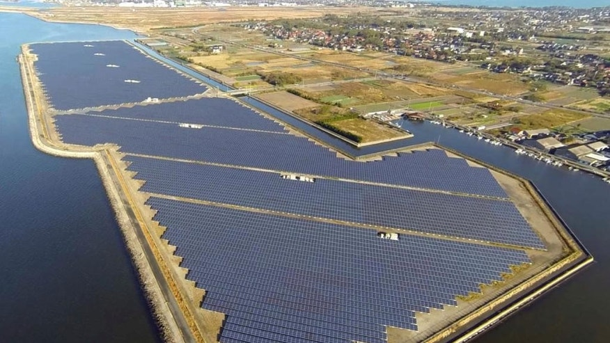 This undated aerial photo released by Softbank Corp. shows the Japanese telecommunications and Internet company's Tottori-Yonago Solar Park which started commercial operation on Feb. 1, 2014 in Yonago, Tottori Prefecture, western Japan. Softbank Corp., which has bought Sprint Corp. of the U.S., moved into the solar business after the Fukushima crisis. Softbank's founder and CEO Masayoshi Son turned against nuclear power and became an advocate of renewables after his mobile networking went dead in the absence of electric power from the nuclear accident in 2011. (AP Photo/Softbank Corp.)