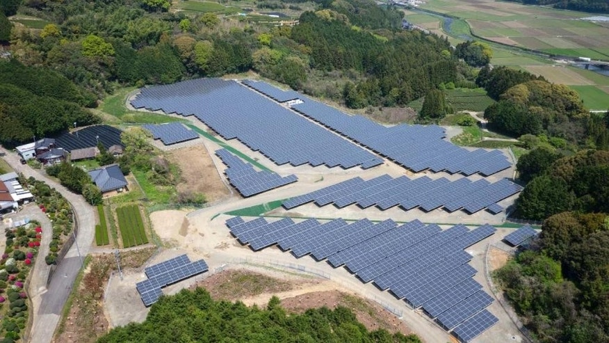 This undated aerial photo released by Softbank Corp. shows the Japanese telecommunications and Internet company's Ureshino-Yoshida Solar Park which started commercial operation on May 1, 2014 in Ureshino, Saga Prefecture, southern Japan. Softbank Corp., which has bought Sprint Corp. of the U.S., moved into the solar business after the Fukushima crisis. Softbank's founder and CEO Masayoshi Son turned against nuclear power and became an advocate of renewables after his mobile networking went dead in the absence of electric power from the nuclear accident in 2011. (AP Photo/Softbank Corp.)