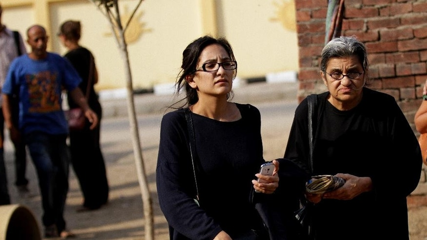 Mona Seif, left, and her mother Laila Soueif, a university professor who is an also an activist, stand outside a court that convicted 23 activists of staging an illegal demonstration and sentenced them each to three years in jail, in Cairo, Egypt, Sunday, Oct. 26, 2014. Among the 23 is Sanaa Seif, who hails from a family of longtime rights campaigners, including her late father Ahmed Seif al-Dawla and brother Alaa Abdel-Fattah. Another defendant is Yara Sallam, a prominent rights lawyer. Sunday's verdicts, which can be appealed, comes at a time when Egypt is swept by nationalist sentiments following a dramatic surge in attacks blamed on Islamic militants on troops and security forces in the Sinai Peninsula while witnessing a smear campaign targeting many of the secular pro-democracy campaigners behind the 2011 uprising. (AP Photo/Hussein Tallal)