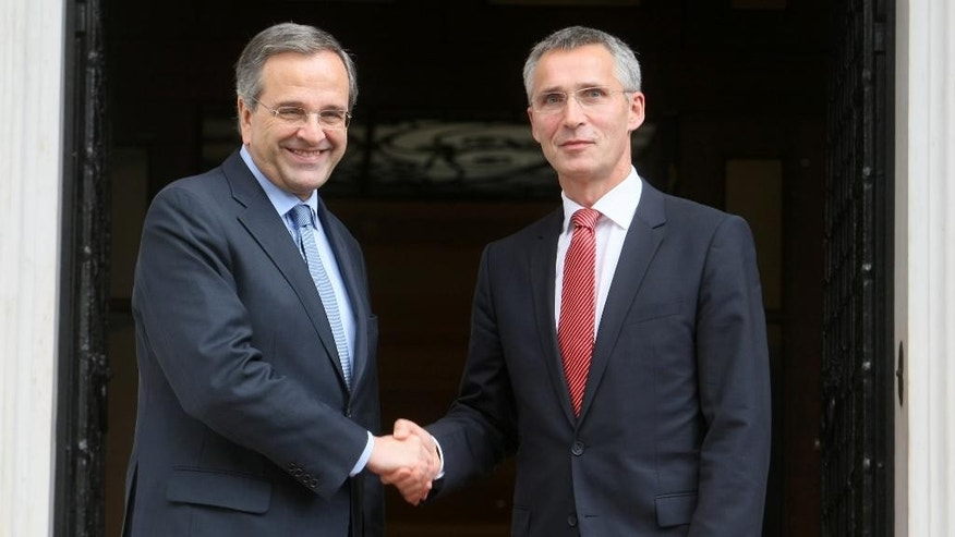 "Greece's Prime Minister Antonis Samaras, left, shakes hands with NATO Secretary General Jens Stoltenberg before their meeting at Maximos Mansion in Athens, Thursday, Oct. 30, 2014. Stoltenberg said the alliance is increasing its readiness and air policing following a spike in airforce activity in eastern Europe by Russia, which he urged to end ""destabilizing actions"" in Ukraine. (AP Photo/Eurokinissi, Tatiana Bolaris) GREECE OUT"