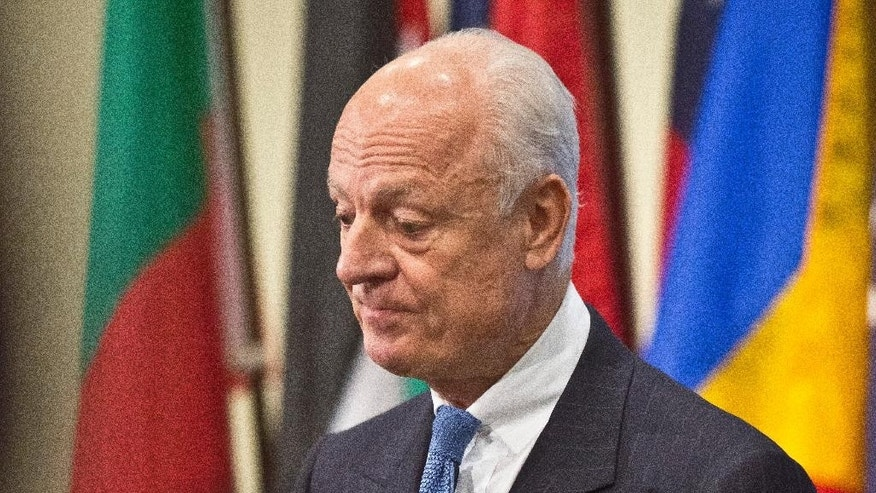 U.N. Syria envoy Staffan de Mistura listens during a press conference after his meeting with the U.N. Security Council, Thursday, Oct. 30, 2014 at U.N. headquarters.  (AP Photo/Bebeto Matthews)