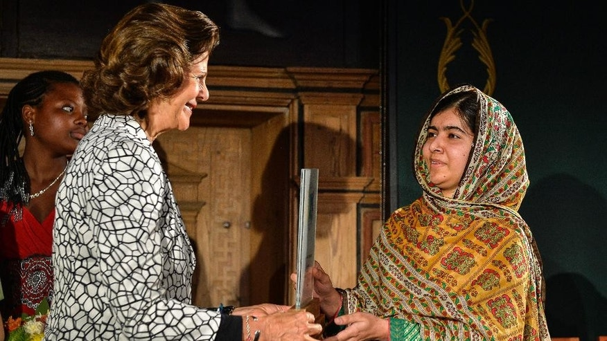 Oct. 29, 2014: Children rights activist Malala Yousafzai, right, receives the World's Children's Prize from Swedish Queen Silvia, left, at Gripsholm Castle in Mariefred, Sweden. (AP/TT News Agency, Anders Wiklund)