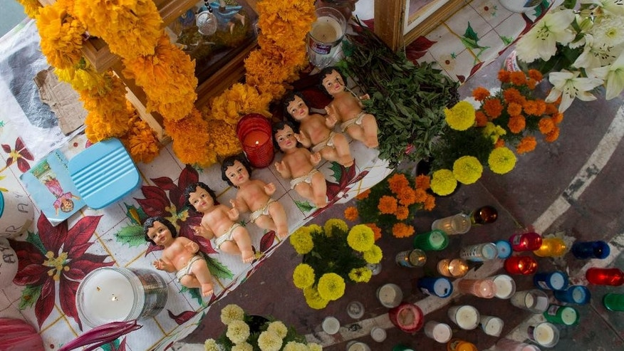 Oct. 29, 2014: Flowers, candles, and dolls representing the Baby Jesus decorate an altar commemorating 43 missing students